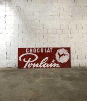 grande plaque publicitaire chocolat poulain metal 1972 5francs 1 172x198 - Ancienne grande plaque publicitaire Chocolat Poulain